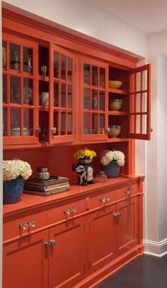 Orange butler's pantry cupboard painted in Benjamin Moore's Dark Salmon