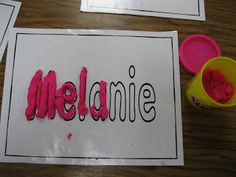 !: Names & Letter Centers - I like the secret name idea: write names in white crayon, paint watercolors over and you see whose name you got!