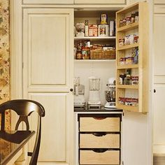 Reach-In Cupboard              Reach-in kitchen cupboards are a good alternative when there's not space for a walk-in pantry. This one is efficient in its combination of shallow shelves, door racks, pullout drawers, and counter storage. Double doors offer easy access, integrate the pantry into surrounding cabinetry, and protect and conceal contents