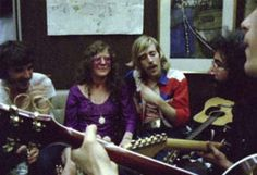 Janis on the Festival Express train, Garcia and Weir in the foreground, Marmaduke of NRPS to her right and Rick Danko of the Band on the left