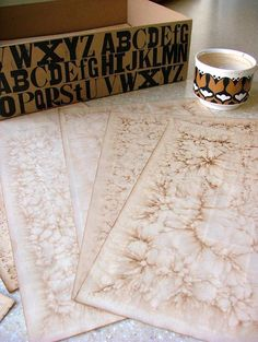 Tea stained papers - this one uses baking soda to neutralize the acidity of the tea