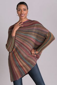 Color Wheel Sweater by Mieko Mintz. With its extraordinary circular form and stunning complex of radiating stripes, this fine wool sweater epitomizes art to wear. The unusual and intriguing shape is created through a collaboration between the artist and a celebrated designer in Japan using cutting-edge knitting technology.