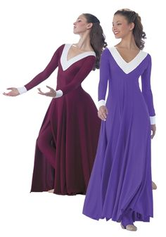 A matte Lycra long sleeve dress, with white Lycra V- yoke collar and cuffs. Skirt is inset four gore open panels over a stirrup unitard.   Retail Price:$140.00 Sales Price:$105.00 You Save:$35.00
