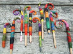 """""""Two weeks ago, my daughter Emily and I spent an afternoon felting some pencil holders, just for fun - you just wrap a pencil tightly with some wool roving, felt it with warm soap water, rinse it and form the upper tail as you please, then let it dry.""""  Lovely!!!!"""