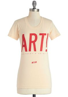 """Art never goes out of style, so make a statement with this cream-colored cotton tee's """"Art! Everybody's Doing It"""" message."""