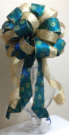 Check out this item in my Etsy shop https://www.etsy.com/listing/245852084/peacock-tree-topper-bow-christmas-bow
