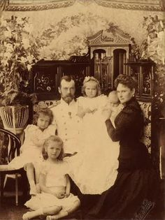 The Imperial Family of Russia on August 16, 1901, Peterhof. From right to left counter-clockwise: Alexandra, two-month-old baby Anastasia, Grand Duchess Maria, Tsar Nicholas II, Grand Duchess Tatiana, and Grand Duchess Olga.