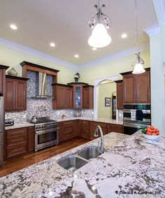 This #kitchen is finished with lovely counter-tops and a tile backsplash. The Kenningstone #1166. http://www.dongardner.com/house-plan/1166/the-kenningstone. #HomePlan #DreamHome
