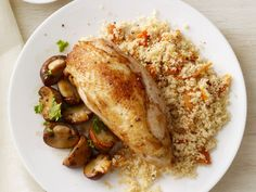 Chicken and Mushrooms with Couscous : Roast chicken breasts along with mushrooms and spices for an ultra-flavorful, easy-to-make weeknight dinner; serve with quick-cooking couscous -- dinner couldn't be simpler, or more delicious.