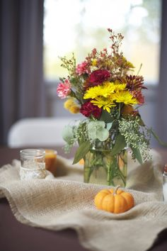 Fall wedding centerpiece   http://rusticweddingchic.com/rustic-fall-wedding