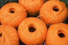 Spools of orange yarn