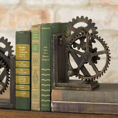 """Turn the crank - these gears actually move! As a celebration of the Industrial age and """"all things mechanical,"""" these heavy-duty, authentic iron bookends lend a masculine feel to library, den or sitting room. Positioned facing or side-to-side, these distinctively heavy-weight sculptural works add a progressive flair that's as contemporary as it is historic."""
