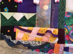 This quilt is called the Easter Egg fidget quilt. It is approximately 22 x 22. The fidget quilt is backed with polar fleece. This quilt has at least ten textures and four fidget items. Fidget items: -Marble maze (Marble is under fabric. If stitching comes loose, the marbles could come out.) -Weaving ribbon -Tugging Ribbon -I Spy (Various items under chiffon. Items could come out if this area is chewed on.)  When I first heard about fidget quilts, I was so excited to have a use for small bits…