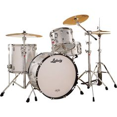 """Is there anything cooler than a set of silver sparkle Ludwigs? This is a Fab 4 Classic Maple Drum Set with 22"""" bass drum."""