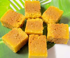 Take a pan and place it on the gas stove.  This sweet will be cooked on low flame.  Add 100 ml of water and 150 grams of sugar to the pan.  Now, heat this solution of sugar and water with stirring till the solution reaches one thread consistency.  After reaching above said consistency, add gram flour with well mixing.  Continue mixing and see that there are no lumps in the pan.  Continue heating till the mixture turns a little,,