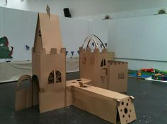 could still do 'a' frame and cut out the squares at top so looks like a castle ---children's cardboard castle wardrobe