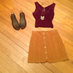 BDG mini corduroy button up skirt with pockets This BDG corduroy skirt snaps up and hits above mid thigh.  Stretchy corduroy material makes it very comfy to wear!  Pockets and belt loops add to the look.  Like new condition!  Fits true to size. Urban Outfitters Skirts Mini