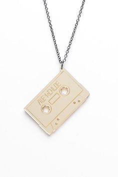 mixtape necklace. #music #tapes #cassette http://www.pinterest.com/TheHitman14/the-audio-tape-%2B/