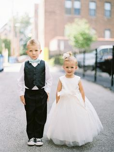 Flower Girl & Ring Bearer -- Adorable!  See the wedding on #smp here: http://www.StyleMePretty.com/midwest-weddings/2014/04/10/nature-museum-wedding-in-chicago-by-yazy-jo/ Photography: YazyJo.com