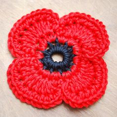 Crochet Flower Patterns Crochet remembrance poppy … - Get those hooks out. here's a free Remembrance Poppy Crochet Pattern. Poppy Crochet, Crochet Poppy Free Pattern, Crochet Puff Flower, Crochet Flower Patterns, Crochet Flowers, Knitting Patterns, Crochet Amigurumi, Knit Or Crochet, Crochet Gifts