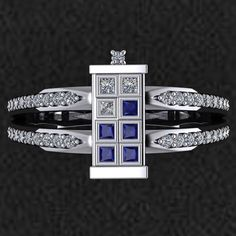 Wear a truly timeless piece of jewelry with the Doctor Who TARDIS Ring. Get it? Timeless? Time Lord? Never mind. Available in a variety of sizes, this eye-catching piece of Gallifreyan technology jewelry features natural SI quality diamonds (G-H color), and natural blue sapphires. It has a to