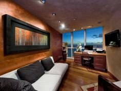 Contemporary office with miles of beach just below the window for inspiration.