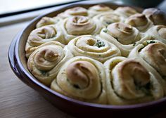 Garlic Rolls recipe - crusty on the outside and soft on the inside -- slathered with garlicky butter and flecked with parsley. YUM.