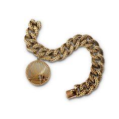 VAN CLEEF AND ARPELS. A fancy link and gem-set charm bracelet