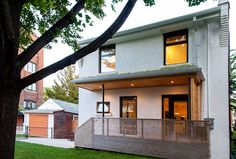 Our House, newly painted white! Passive Solar Design   Sustainable Building   Solares Architecture