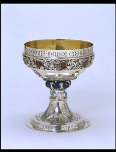 Silver Cup:  London 1863-1864.   Burges, William (A.R.A.) (designer)   Hart, Charles (maker)   Joseph Hart & Son (maker)      Silver, parcel-gilt, set with applied ornament and enamelled