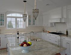Traditional L-shaped Cream kitchen, white cabinets ~ like the windows & the white trim ~ nice hardware ~ looks nickel plated ~