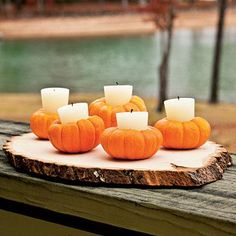 Votive candles in mini pumpkins!
