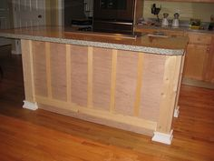 Island board and batten...maybe something like this and painted out in a dark blue gray