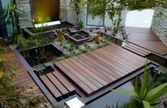 Amazing backyard deck and water feature  combination
