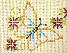 A butterfly motif I cross-stitched from the Stamped Goods sampler, found in Better Homes & Gardens Beautiful Cross Stitch book. Simple Embroidery, Japanese Embroidery, Hand Embroidery Stitches, Cross Stitch Embroidery, Embroidery Patterns, Ribbon Embroidery, Cross Stitch Books, Modern Cross Stitch, Cross Stitch Designs