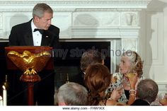 President George W. Bush looks at Eunice Kennedy Shriver before he gives a speech