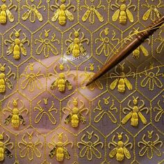 goldwork bees embroidered onto silk organza / The tool is a tambour hook / embroiderer Sylvie Deschamps / http://www.broderieor.com/11-haute-couture.html