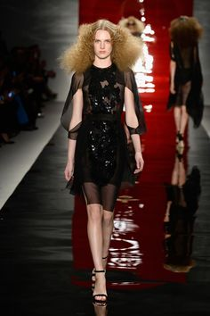 A model walks the runway at the Reem Acra fashion show during Mercedes-Benz Fashion Week Spring 2014 at The Stage at Lincoln Center on September 9, 2013 in New York City.