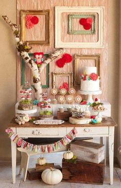 Love the frames and table decor