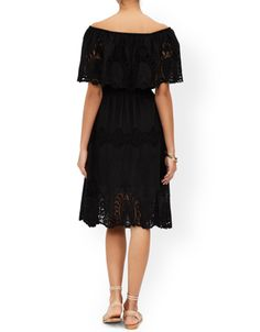 Our seventies-inspired Marilyn midi dress is designed to sit off-the-shoulder, framing the décolletage. The ruffled crop overlay is decorated with cutwork embroidered patterns that extend down to the hemline. The elasticated waist seam enhances the narrowest part of your silhouette, while concealed elastic tape inside the bodice offers extra support. Model wears UK 8/UK S/EU 36/US 4. Model height is 175 cm/5'9.