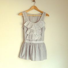 Anthro - stripe ruffle top Sleeveless pin stripe ruffle tue back sleeveless top. Silver stripes as well as black and white. Gently used condition. Anthropologie Tops Blouses