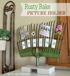 Rusty Rake Picture Holder made from an old rake and a trophy base from My Salvaged Treasures