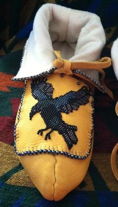 I think I need a pair of these Beauties....So Cool!!! Handmade Native American Beaded Raven Moccasins by CherokeeAsi