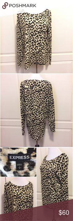 """Express Leopard Animal Print Knit Tunic Sweater S Express cheetah/ leopard animal print tunic sweater. Size small. NEW WITHOUT TAG! No flaws. Boat neckline (wider crew neck.) Long sleeves. 100% knit poly. Soft, lightweight, stretchy sweater material. Slightly longer length in the back with a rounded hem. Covers the booty. Relaxed fit. Looks gorgeous with skinny jeans or leggings!  Approx 20"""" across the bust, unstretched. Approx 29"""" long down the center back. Smoke-free home. No trades…"""