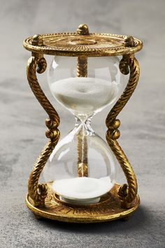 The hourglass symbolizes the eternal passage of time and is a reminder of man's mortality.