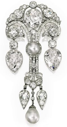 Belle Epoque Natural Pearl and Diamond Brooch, circa 1910 • Features three Golconda-type diamonds of 8.67 carats, 8.78 carats, and 9.59 carats • Photo: Sotheby's