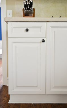 Painted Kitchen Cabinets Before and After--Benjamin Moore Advance paint in White Dove (satin finish)