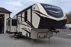 """TONS OF SPACE!!!  2017 CrossRoads Cruiser 3391RL With two large slides in the main living area and one in the bedroom, you'll enjoy an open layout! The kitchen is large enough to accommodate an island while the bedroom is so large, that is houses a huge king bed! This rig is 37' 3"""" long and has a shipping weight of 10,518 lbs. Give our Cruiser expert Bob Mosher a call 989-670-3058 for pricing and more information."""