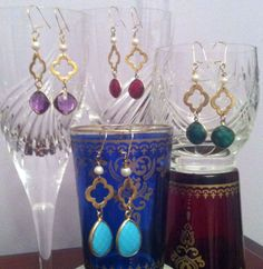 Earrings made of fresh water pearls, gold vermeille, and amethyst, ruby, emerald or turquoise stones.