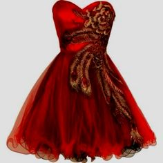 I want this dress for homecoming. It was in my dream last night. I was dressed as Katniss, the girl on fire, and I had on red heels with a flamey design.